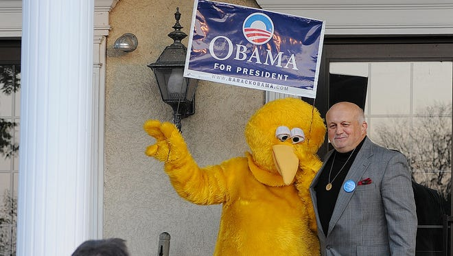 """Jake Long of Annville, poses with """"Big Bird"""" outside of the Lantern Lodge Myerstown at the annual Lebanon County Democrats Jefferson-Jackson Dinner."""