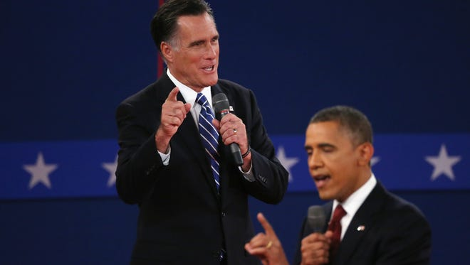 Mitt Romney and President Obama at the debate Oct. 16.