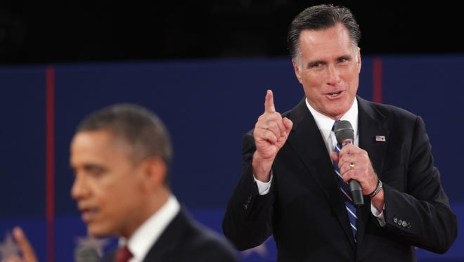 President Obama and Mitt Romney debate on Oct. 16.
