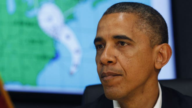 President Obama makes a statement after a briefing on Hurricane Sandy at FEMA Headquarters on Sunday.