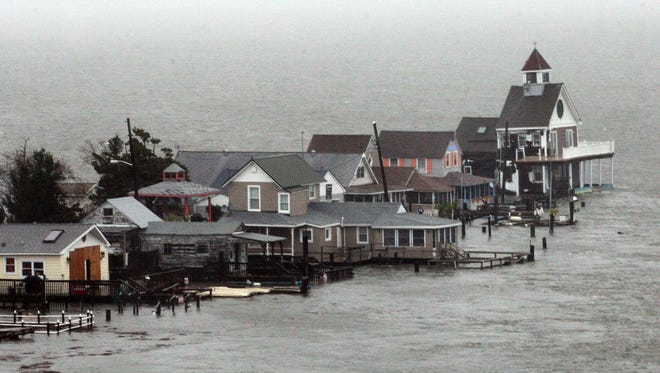 A row of houses stands in floodwaters at Grassy Sound in North Wildwood, N.J., as Hurricane Sandy pounds the East Coast on Oct. 29.