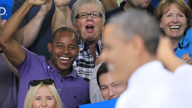 Supporters cheer President Obama during a campaign event in Ohio.