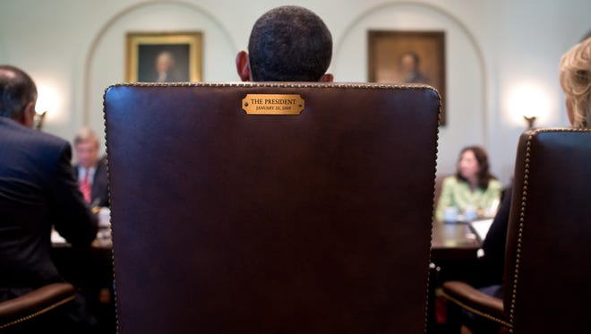 President Obama conducts a Cabinet meeting in 2012.