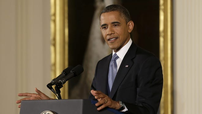 President Obama answers a question during a news conference at the White House Nov. 14.