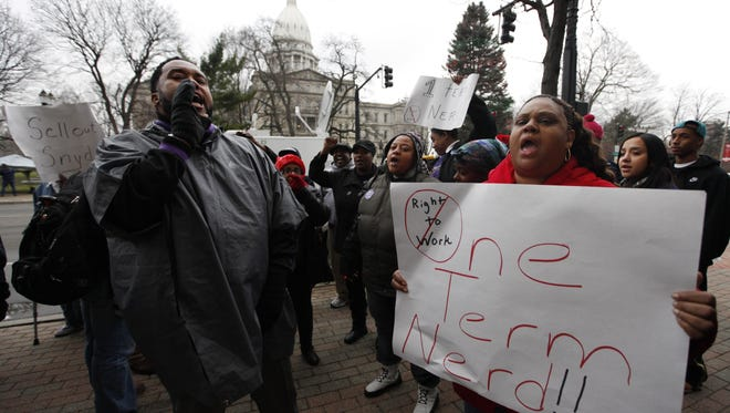 Demonstrators protest right-to-work legislation in Michigan.