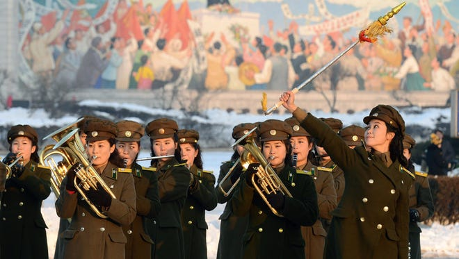 Female members of a North Korean military band perform in celebration of the country's rocket launch in Pyongyang, North Korea.