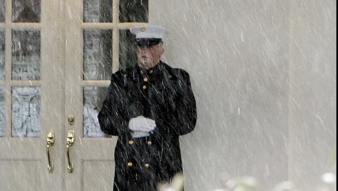A Marine sentry during a 2010 snowstorm.