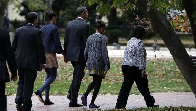 President Obama, his family, and a Secret Service agent