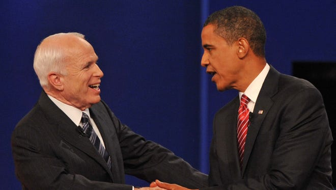 John McCain shakes hands with Barack Obama before one of their 2008 presidential debates.