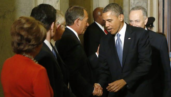 President Obama and House Speaker John Boehner before Monday's inauguration ceremony.