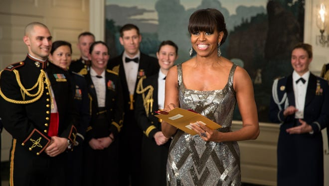 Michelle Obama presents the Oscar for Best Picture.