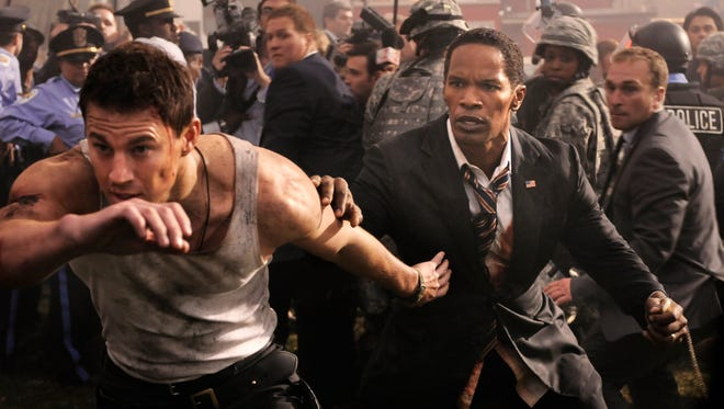 """Channing Tatum, left, and Jamie Foxx in a scene from the motion picture """"White House Down."""""""