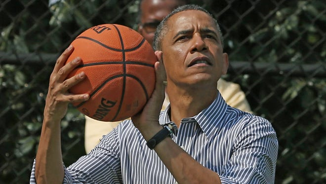 President Obama looks for the range.