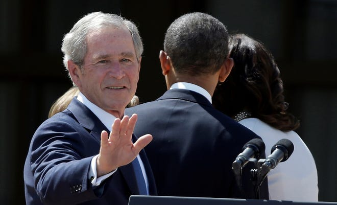 Former president George W. Bush with President Obama