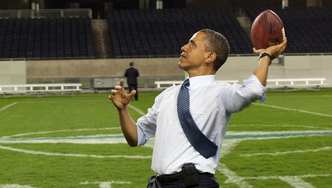 President Obama tosses a football in Chicago in 2012