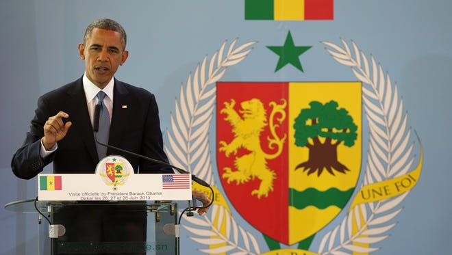 President Obama speaks at a news conference with Senegalese President Macky Sall at the Presidential Palace in Dakar.