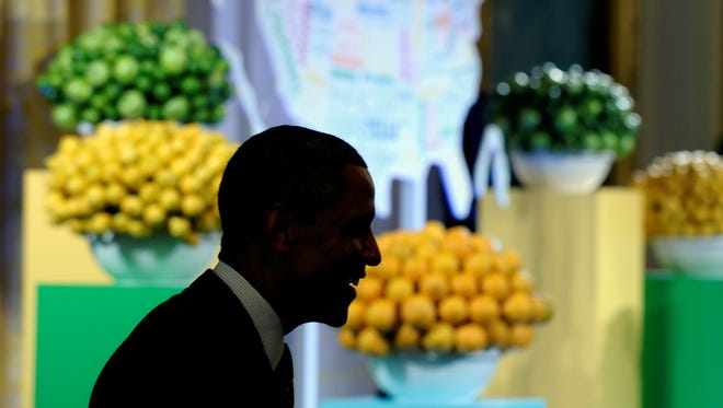 """President Obama greets guests of the second annual White House """"Kids' State Dinner"""" on Tuesday."""