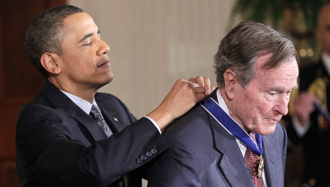 President Obama awards George H.W. Bush a Medal of Freedom.