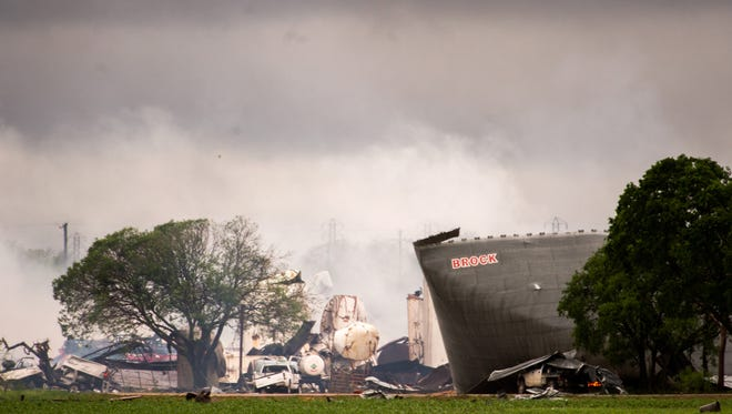 The remains of the the West Fertilizer Co. plant smolder in the rain on Thursday, April 18, 2013, in West, Texas.