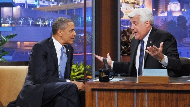 President Obama chats with host Jay Leno during a taping of 'The Tonight Show' at NBC Studios Burbank, Calif.