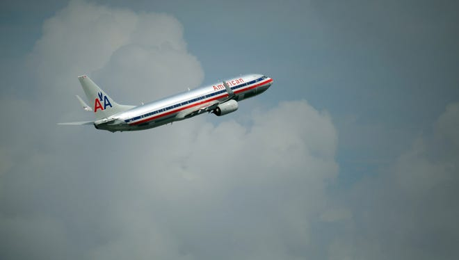 An American Airlines plane takes off from Miami International Airport on Sept. 25, 2012.