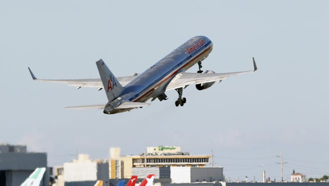 In this Aug. 18, 2010 photo, an American Airlines Boeing 757 jet takes off from Miami International Airport.