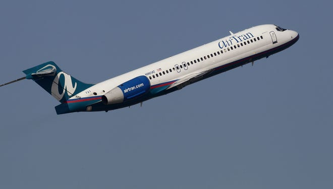 An AirTran Boeing 717-200 takes off from Tampa on Jan. 20, 2011.