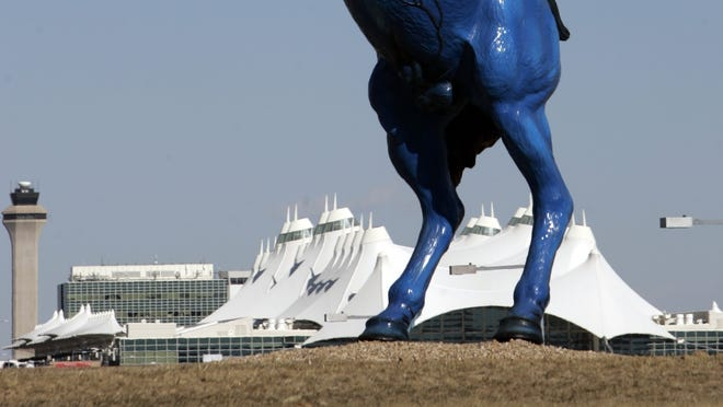 """The 32-Foot blue """"Mustang"""" sculpture is seen at Denver International Airport with the terminal in the background on Feb. 6, 2009."""