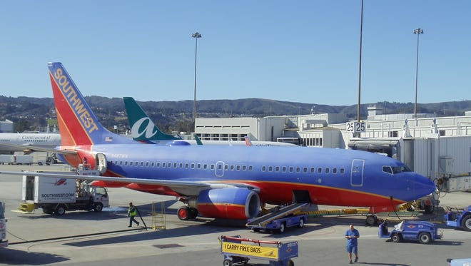 Southwest and AirTran aircraft at gates at San Francisco International Airport on Nov. 8, 2010.