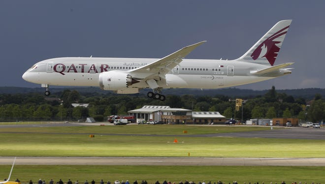 A Qatar Airways Boeing 787 Dreamliner lands during an aerial display at the Farnborough International Airshow in England on July 11, 2012.