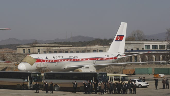 North Korean officials wave at foreign visitors from the tarmac next to an Air Koryo jet at the Pyongyang airport in this Feb. 27, 2008 photo. Air Koryo jets once traversed the skies of the Eurasian landmass, linking communist North Korea with airports in Cold War capitals as far afield as Moscow, Prague and the former East Berlin.  Nowadays, the aging Russian-built craft of the rickety state airline mostly ply routes close to home, with flights beyond nearby Chinese cities and Russia's Far East extremely rare.