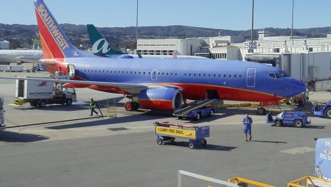 Southwest and AirTran aircraft at gates at San Francisco International Airport on Nov. 8, 2010.
