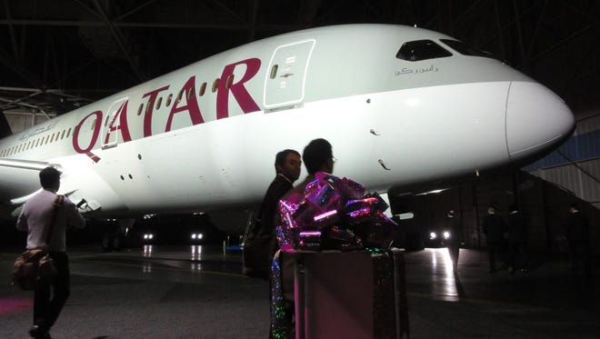 Qatar Airways' Boeing 787 Dreamliner is unveiled at a handover ceremony at Boeing Field in Seattle on Nov. 12, 2012.