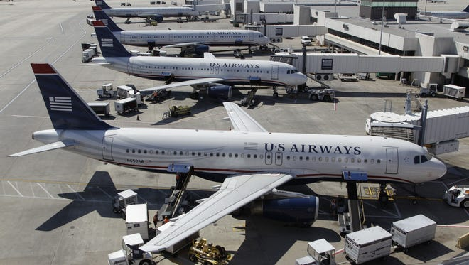 US Airways jets at the Charlotte/Douglas International Airport on Sept. 27, 2012.