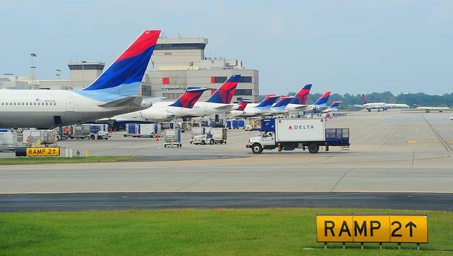 This Sept. 12, 2009, file photo shows Delta Air Lines jets at Hartsfield-Jackson Atlanta International Airport.