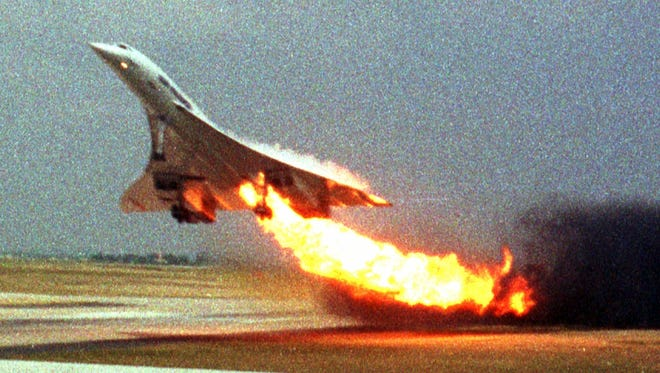 In this July 25, 2000, file photo, Air France Concorde flight 4590 takes off with fire trailing from its engine on the left wing from Charles de Gaulle airport in Paris.