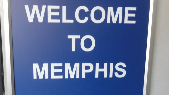 In this photo from April 5, 2012, a Delta Air Lines sign welcomes customers to its Memphis hub.