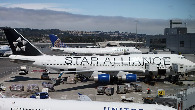 United to make San Francisco its Boeing 747 hub: United says it plans to base most of its fleet of Boeing 747s there, a move that the carrier hopes will streamline maintenance and improve the reliability of its fleet. Pictured here, two United Airlines Boeing 747s are seen in the background at San Francisco International Airport on July 26.