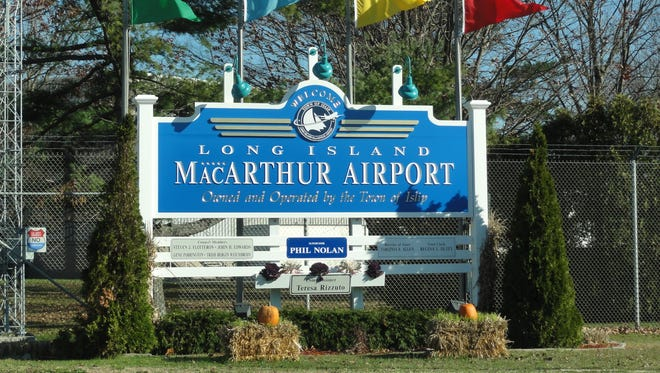 This Nov. 24, 2011, photo shows a sign welcoming travelers to Long Island's MacArthur Airport in New York.
