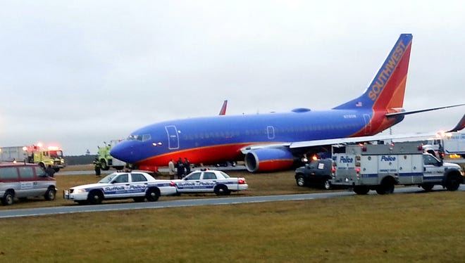 Rescue personnel respond to a Tampa-bound Southwest Airlines jet after it veered off the runway and got stuck in the mud at McArthur Airport in Ronkonoma, N.Y., Thursday, Dec. 27. Officials say there were no injuries to the 129 passengers and five crew members.