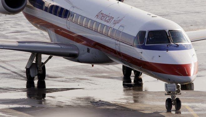 In this Jan. 20, 2011, file photo, an American Eagle jet taxis at Boston's Logan International Airport.