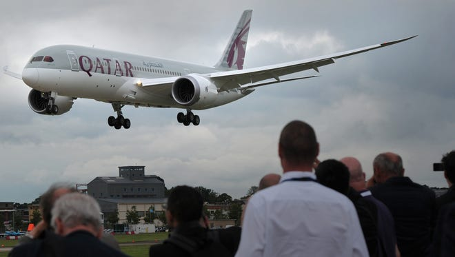 A Qatar Airways Boeing 787 Dreamliner flies at the Farnborough International Airshow in England on July 9, 2012.