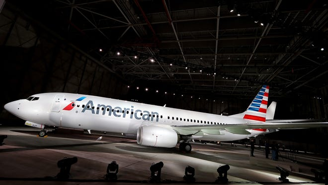 American Airlines unveils a new company logo and exterior paint scheme on a Boeing 737-800 aircraft on January 17, 2013 near Dallas.
