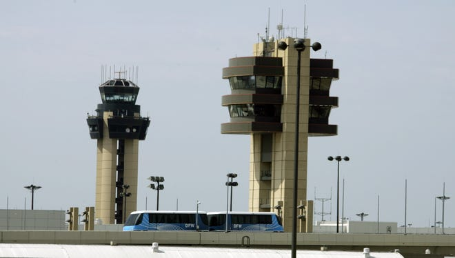 A Skylink tram passes in front of control towers at the Dallas-Fort Worth International Airport on Aug. 10, 2008.