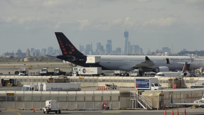 The New York City skyline can be seen behind as a Brussels Airlines Airbus A330-300 jet is serviced at New York JFK International Airport on Oct. 18, 2012.