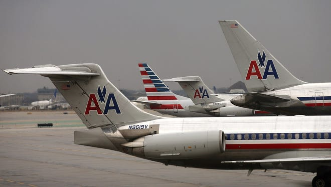An American Airlines Boeing 737-800 featuring the carrier's new tail design is seen at a gate at Chicago O'Hare Airport on Jan. 29, 2013.