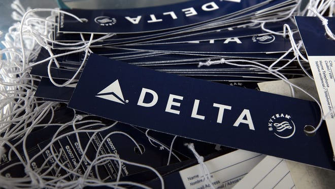 Delta luggage tags sit in a basket at a skycap kiosk at San Francisco International Airport on Jan. 12, 2010.