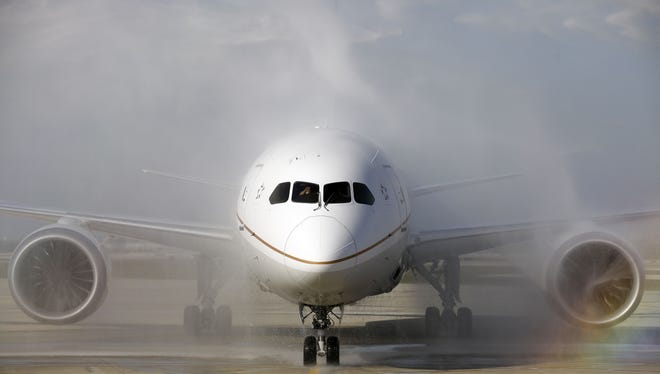 A United Airlines 787 Dreamliner receives a ceremonial water-cannon salute as it arrives at O'Hare international Airport in Chicago on Nov. 4, 2012.