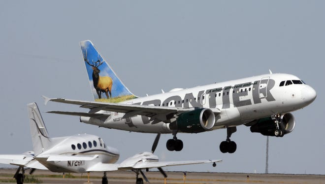 A Frontier Airlines airplane takes off from Denver International Airport on Sept. 27, 2007.