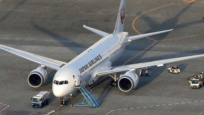 A Japan Airlines 787, from which fuel spilled at Boston's Logan International Airport last Tuesday, sits on the tarmac at Narita Airport in Narita east of Tokyo on Jan. 13, 2013.